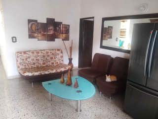 Una sala de estar llena de muebles y una chimenea en Casa en venta en Rosales, 197mt con terraza