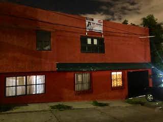 Un edificio de ladrillo rojo con un edificio de ladrillo rojo en Casa en Venta en Tierra Blanca Ecatepec de Morelos