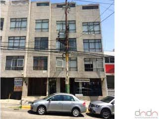 Un coche estacionado delante de un edificio alto en Departamento en venta en Ciudad Satelite de 2 alcobas