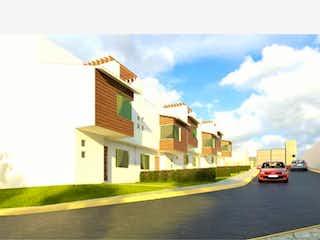 Un coche está estacionado en el lado de la carretera en Casa en venta en Jardines De San Miguel III 166m² con Bbq...