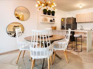 Una cocina con una mesa de comedor y sillas en Villaterra