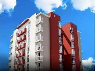 Un edificio alto con una señal en él en Departamento en Venta en Colinas de San José Tlalnepantla de Baz