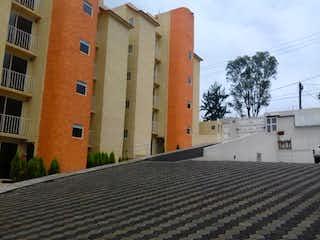 Un edificio de ladrillo alto con un reloj en él en Departamento en Venta en Lomas Lindas II Sección Atizapán de Zaragoza