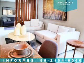 Una sala de estar llena de muebles y una mesa en Departamento en Venta en Hacienda del Parque 2a Sección Cuautitlán Izcalli