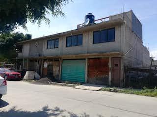 Un pájaro sentado en la parte superior de un edificio en Casa en Venta en Santa Cruz Valle de Chalco Solidaridad