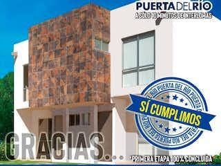 Una imagen de un edificio con una señal en él en Casa en venta en La Mancha 1, 102m² con Jardín...