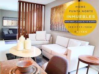 Una sala de estar llena de muebles y una gran ventana en Departamento en Venta en Hacienda del Parque 2a Sección Cuautitlán Izcalli