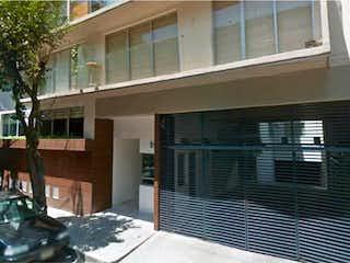 Un gran edificio de ladrillo con una gran ventana en Departamento en venta en Ampliación Nápoles, 100m²