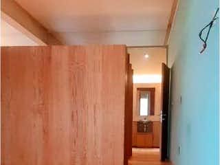 Una imagen de una persona de pie en una puerta en Departamento en venta en Tabacalera 89m² con Gimnasio...