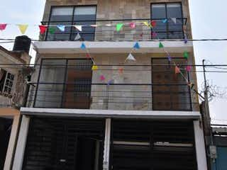 Un edificio alto con muchas ventanas en Departamento en Venta en El Olivo II Parte Baja Tlalnepantla de Baz