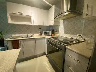 Una cocina con una estufa de fregadero y horno en Departamento en Venta en La Esmeralda Gustavo A. Madero