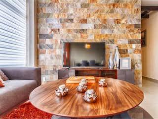 Una sala de estar llena de muebles y una chimenea en Departamento en Venta en Hacienda del Parque 2a Sección Cuautitlán Izcalli