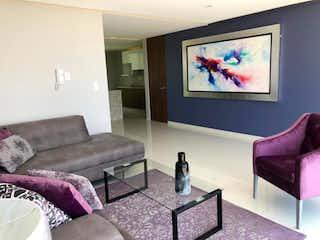 Una sala de estar llena de muebles y una televisión de pantalla plana en Casa en Venta en Residencial Lago Esmeralda Atizapán de Zaragoza