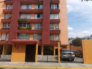 Un edificio de ladrillo rojo con un edificio de ladrillo rojo en Departamento en Venta en Jardines de Atizapan Atizapán de Zaragoza