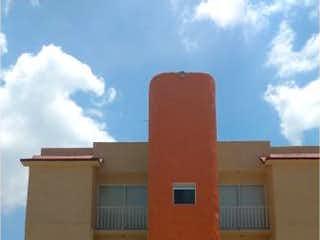 Un edificio muy alto sentado junto a una boca de incendios amarilla en Departamento en Venta en Lomas Lindas II Sección Atizapán de Zaragoza