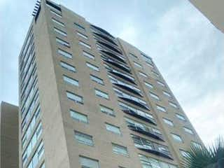 Un edificio muy alto con una ventana grande en Departamento en Venta en Lomas Verdes 1a Sección Naucalpan de Juárez