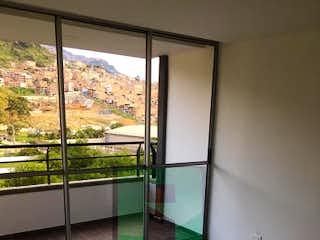 Una ventana con una puerta de cristal y una ventana en Apartamento en Venta MACHADO