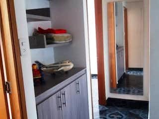 Una cocina con nevera y fregadero en Apartamento en venta en El Portal 76m²