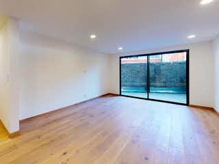 Una vista de una sala de estar y comedor en Sindicalismo 20