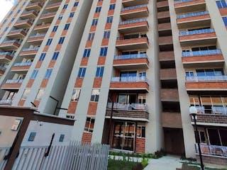 Un edificio alto con muchas ventanas en Apartamento en Venta MACHADO