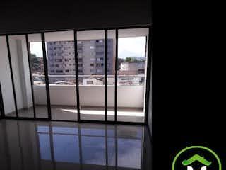 Una ventana que tiene un reloj en ella en Apartamento en Venta LA CASTELLANA