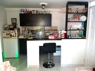 Una cocina con un montón de artículos en la pared en APARTAMENTO EN VENTA EN LORETO