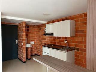Una cocina con un fregadero y una estufa en VENTA APARTAESTUDIO SECTOR MOLINOS