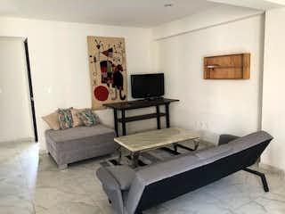Una sala de estar llena de muebles y una televisión de pantalla plana en AUGUSTO RODIN, DEPTO VENTA CON BALCON