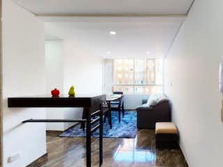 Una sala de estar llena de muebles y una mesa en Apartamento en venta en Porvenir con acceso a BBQ