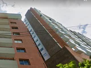 Un gran edificio de ladrillo con un banco en él en APARTAMENTO EN ENVIGADO