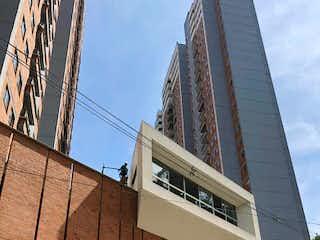 Un edificio alto con un reloj encima en Apartamento en Venta SAN JOSE