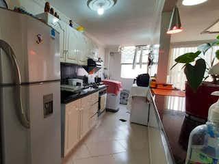 Cocina con nevera y horno de fogones en Apartamento en venta en Comuna 13 de 72m²