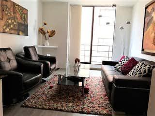 Una sala de estar llena de muebles y una chimenea en Apartamento en venta en Santa Bárbara Occidental de 73m² con Bbq...