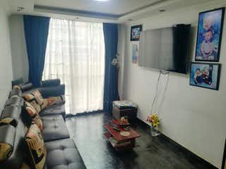 Una sala de estar llena de muebles y una ventana en Balcones de Engativa