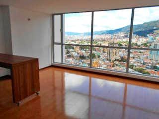 Una vista del horizonte de la ciudad desde una ventana en Apartamento En Venta En Bogota La Sabana