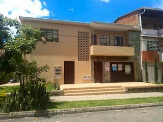 Una esquina con un edificio en el fondo en Edificio en San Javier con 6 locales y un apartamento