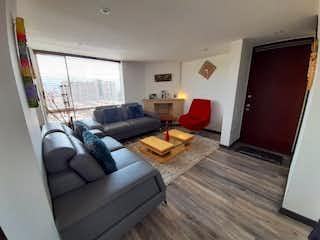 Una sala de estar llena de muebles y una chimenea en Apartamento en venta en Prado Veraniego, 139mt