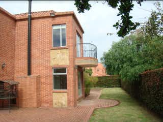 Un edificio de ladrillo con un edificio de ladrillo rojo en Casa en venta en Bojacá con Jardín...