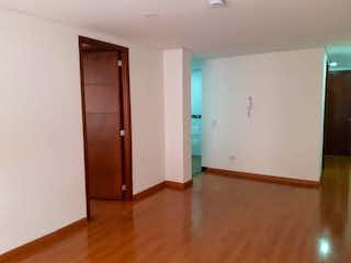 Una habitación que tiene un refrigerador en ella en VENTA DE APARTAMENTO BATN (SUBA)