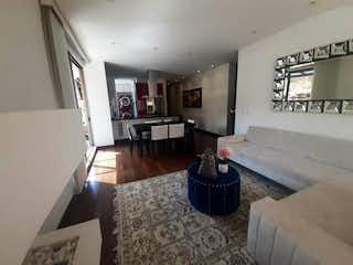 Una sala de estar llena de muebles y una chimenea en Apartamento En Venta En Bogotá Chico Navarra