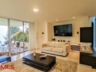 Una sala de estar llena de muebles y una televisión de pantalla plana en Villas de la Candelaria