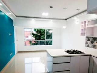 Una cocina con una estufa blanca encima del horno en Apartamento en Venta Sector Estadio
