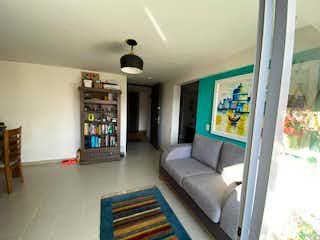 Una sala de estar llena de muebles y una chimenea en Apartamento en venta en San Germán, 62mt
