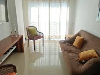 Una sala de estar llena de muebles y una ventana en Apartamento en Venta VELODROMO