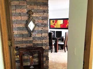 Una vista de un pasillo con una puerta abierta en Apartamento en venta La Castellana