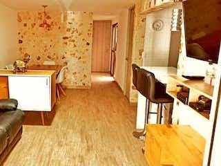 Una sala de estar llena de muebles y una chimenea en Casa en venta en Santa Ana de 3 alcoba