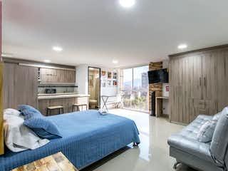 Un dormitorio con una cama y un sofá en Little beauty 3 at La Frontera