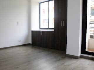 Un pasillo que conduce a un pasillo con una puerta en Venta Apartamento Batan, Bogotá
