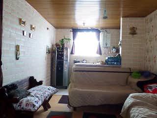 Una habitación de hotel con una cama y un sofá en Apartamento en Venta CENTRO