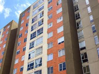 Un edificio de ladrillo rojo con un edificio de ladrillo rojo en Apartamento en Venta SUBA COMPARTIR